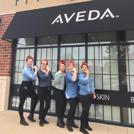 The team from Five Senses Spa, Salon & Barbershop in Peoria, IL, demonstrate their 'We Can Do It' spirit. 