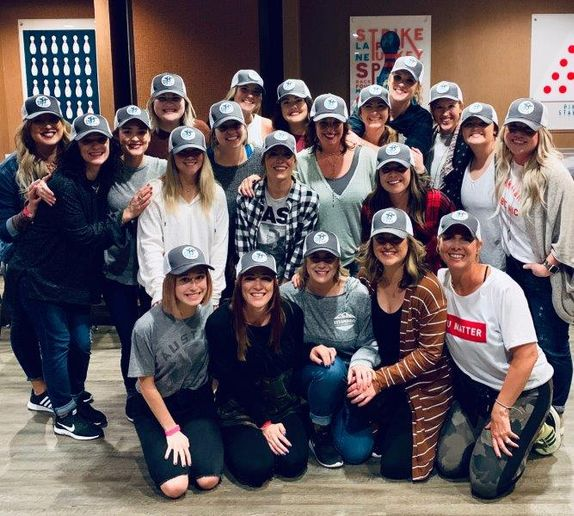 Sporting matching hats, the team from DV8 The Salon in Grapevine, TX. 