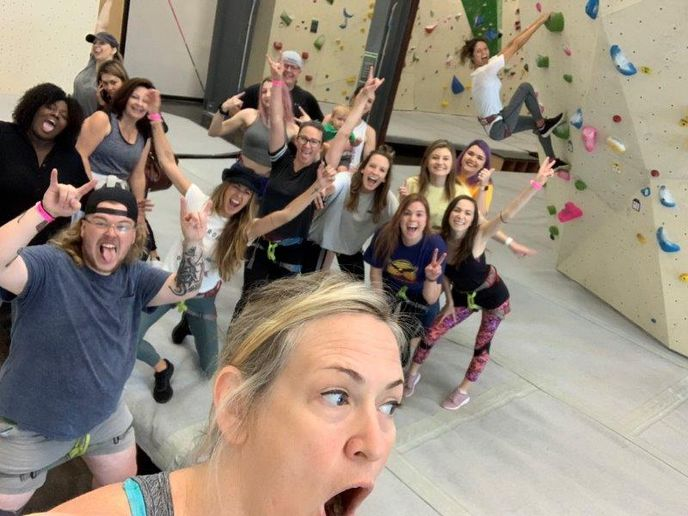 The team at Tangerine Salon and Spa in Murfreesboro, TN, enjoy a rock climbing activity. 