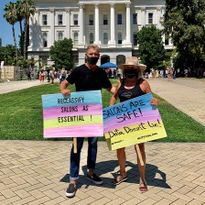 Headlines The Salon Owners David Linde and Gayle Fulbright protest outside the California...