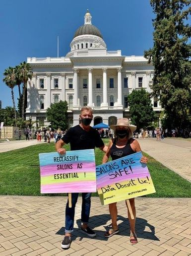 Headlines The Salon Owners David Linde and Gayle Fulbright protest outside the California capitol building in an effort to reopen salons after the state's second shutdown.  -