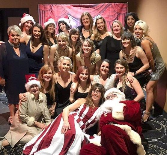 Santa Claus makes a special appearance in a holiday photo taken with the team from Legato Salon and Spa from Farmington and Birmingham, MI.  -