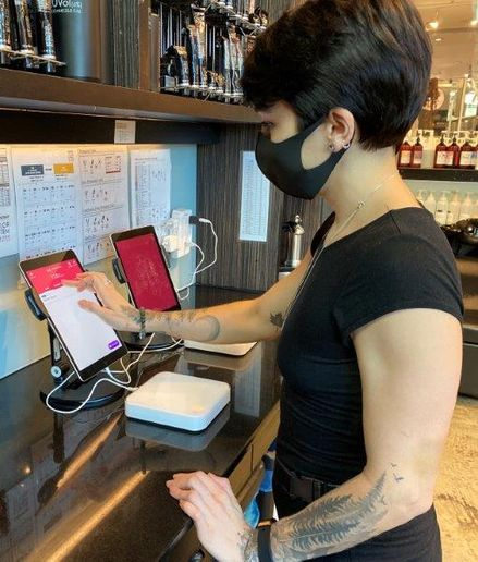 A stylist checks a formula using the Vish Color Management system.   -