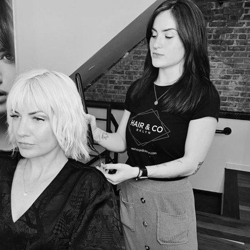 Hair + Co BKLYN's Rhianna Boyd completes a blonding service for fellow stylist Liz Loeffler.   -