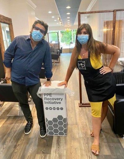 Owner Hernan Prada and Salon Director Alexa Cikoja encourage guests to safely dispose of their PPE. 