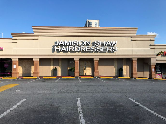 While boarded up, Jamison Shaw in Atlanta escaped damage while 19 stores in their mall location were not so fortunate.