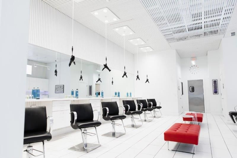 <p>Against an almost white background, the red seating at Jon Alan Salon in Nashville, immediately draws the eye.&nbsp;</p>