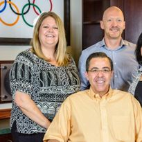 The leadership team from V's Barbershop, from left, COO Emily Brown, CEO Jim Valenzuela, VP of...