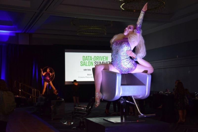 <p>At the networking cocktail party sponsored by Minerva, an acrobat performs in one of the company&#39;s styling chairs.&nbsp;</p>