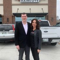 Sport Clip's Edward Logan and Belinda Gambuzza, co-founder of The Visage Group, in front of one...