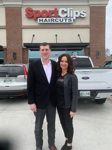 Sport Clip's Edward Logan and Belinda Gambuzza, co-founder of The Visage Group, in front of one of the seven Knoxville Sport Clips locations they are partnering on.