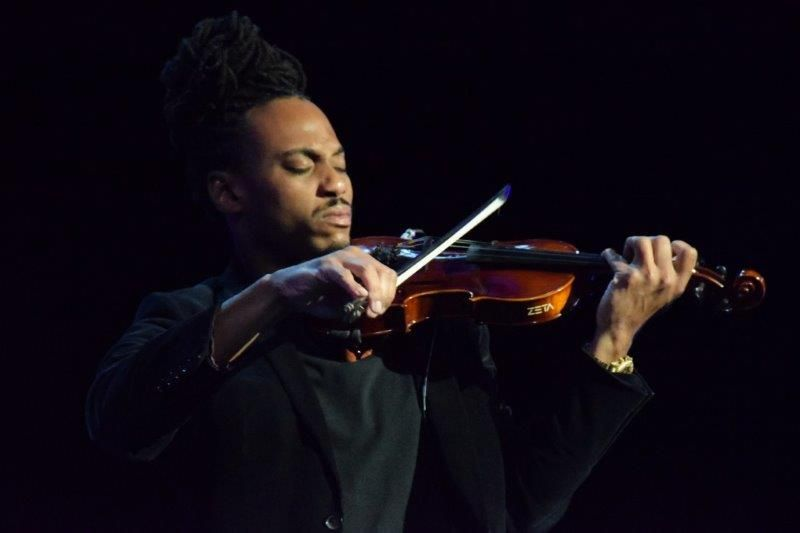 <p>Violinist T. Ray closes the first day of Serious Business with an uplifting performance of <em>Rise Up</em>.&nbsp;</p>