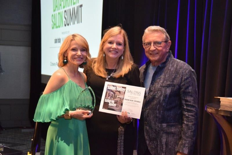 <p>The 2020 Salon of the Year will pick up its trophy at this year&#39;s Data-Driven Salon Summit. Here, last year&#39;s winners, Debra and Chuck Penzone collect the grand prize from SALON TODAY Editor Stacey Soble.</p>