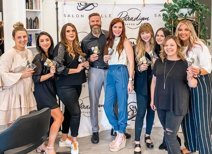 Owners Travis and Adelle Graham (center) and their team prepare to welcome local cosmetology students to the first stop on the salon crawl.   - Ivy Boudakian