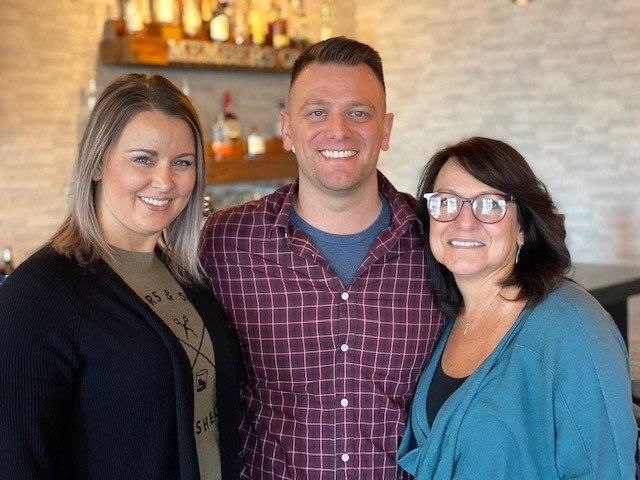 Rachel and Eric Plunkett, co-owners of Scissors + Scotch, and Sonja Plunkett, minority owner and industry expert. 