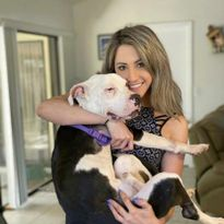 Amber Batteiger and her foster dog Tux.