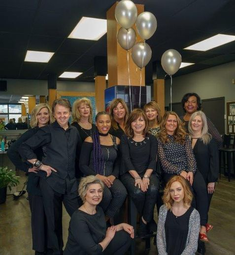 The team from Metropolis Hair Fashions in Knoxville, Tennessee, including Scott Stuart (second from left) celebrate their win of SALON TODAY's 2019 Total Salon Makeover competition. 