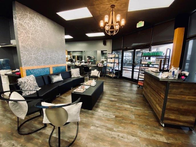 The new front desk from Minerva is more inviting for guests, and it's smaller footprint allows the team to expand their work space on days when they convert the salon into a classroom. 