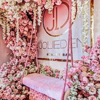 This swing surrounded by flowers entices clients to snap a picture at the Jolieden Beauty Bar in...