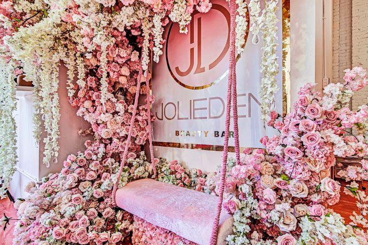 This swing surrounded by flowers entices clients to snap a picture at the Jolieden Beauty Bar in New York.   -