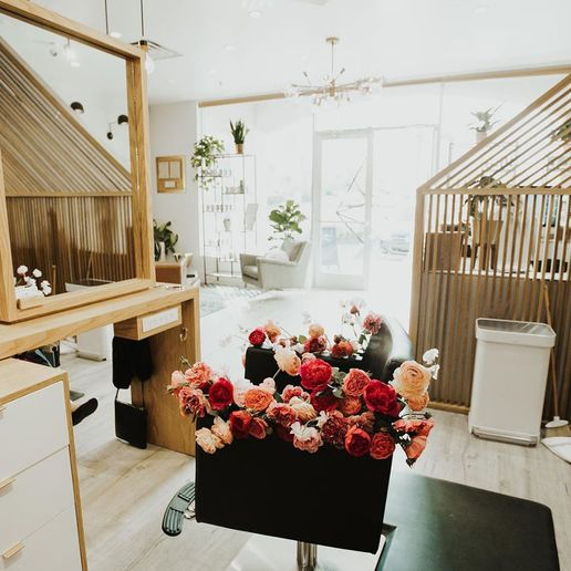 At Wildflower Salon, a station that can't be used at the moment because of social distancing, holds flowers that are distributed to guests.   -