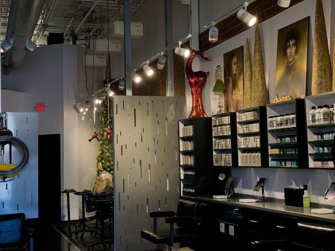 With the current 25% capacity restrictions from Missouri, Blu can only accommodate four clients at a time. So the Gillicks negotiated a month-to-month lease on a storefront four doors down, allowing them to create a pop-up salon that keeps their entire team working. 