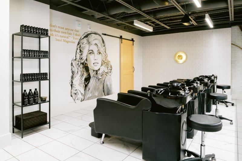 <p>The Lather Lounge features a mural of Dolly Parton&#39;s&nbsp;character Truvy from&nbsp;<em>Steel Magnolias,&nbsp;</em>and her quote: &quot;I don&#39;t trust anyone who does their own hair. I don&#39;t think it&#39;s normal.&quot; The mural was a favorite feature at Grow&#39;s former location so was lovingly recreated by a local artist. In the lounge, every guest receives a scalp massage and a weighted blanket.</p>