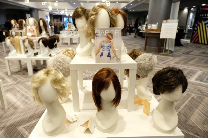 <p>HAIR+ attendees were encouraged to experience a variety of wigs and toppers at the HairUWear stations.</p>