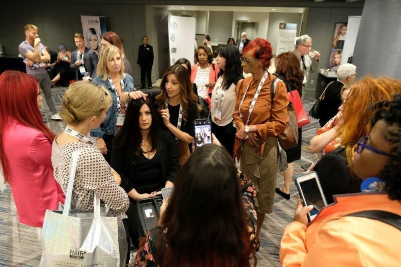 <p>Christina Jones attracts a crowd with her wig demonstration.</p>