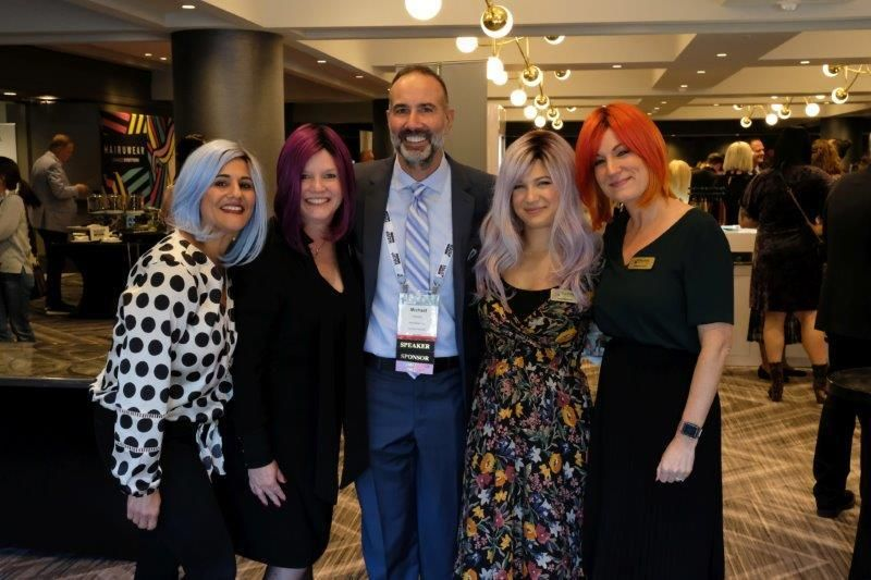 <p>Michael Ferarra with the MODERN SALON Media team, including Angela Reich, Stacey Soble, Jamie Newman and Katharine Cook Reffruschinni,&nbsp;who had a blast&nbsp;trying on HairDo wigs.</p>