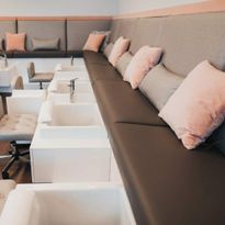 A large, L-shaped pedicure bench makes room for eight guests to experience pedicures...