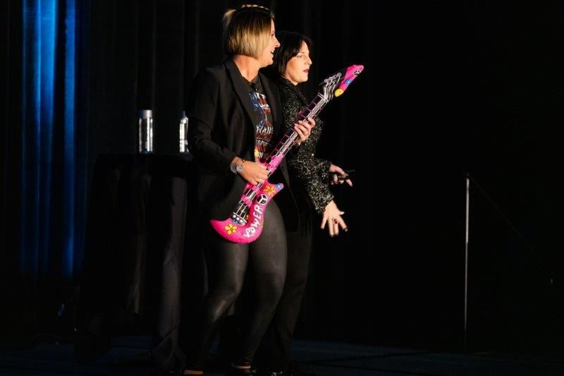 <p>Before their session on futuristing KPIs, Jen LeBlanc and Rowena Yeager rock the audience with their song<em> Talk Data to Me</em>.</p>