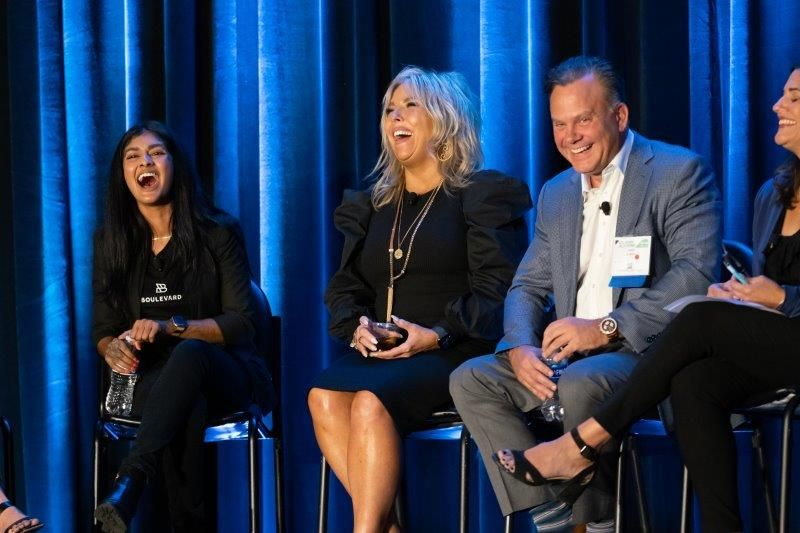<p>Boulevard&#39;s Shanalie Wijesinghe, Hair Success Salons and Day Spas&#39; Jill Krahn and Millennium&#39;s John Harms share a laugh while talking about tools to rebuild business on their panel session.&nbsp;</p>