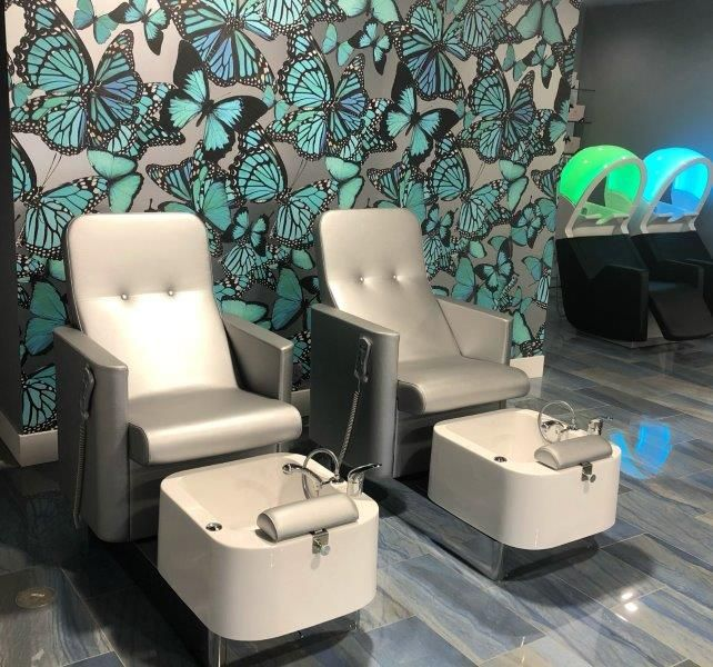 <p>At PF International Salon, Spa Suites and Barer in Sherman Oaks, California, blue granite floors and Morphie butterfly wallpaper tell a color story in blues.&nbsp;</p>