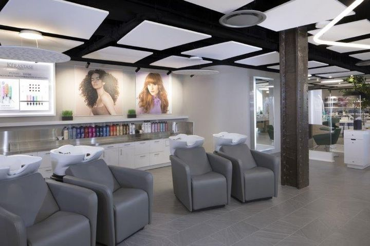 Dim lighting in the shampoo area encourages relaxation.   -